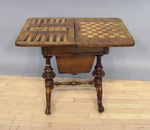 1167: Victorian walnut metamorphic game table, late 19t