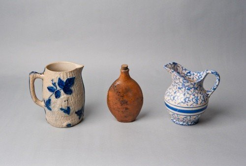 520: Stoneware pitcher, together with a blue sponge pi