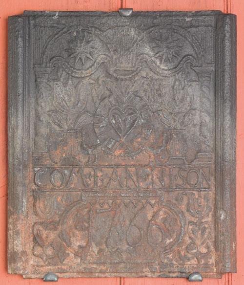 8: H. Wilhelm Stiegel cast iron stove front plate d