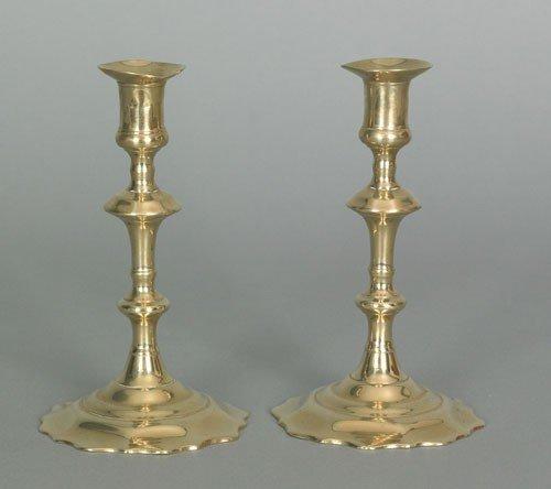 11: Pair of English Queen Anne brass candlesticks, c