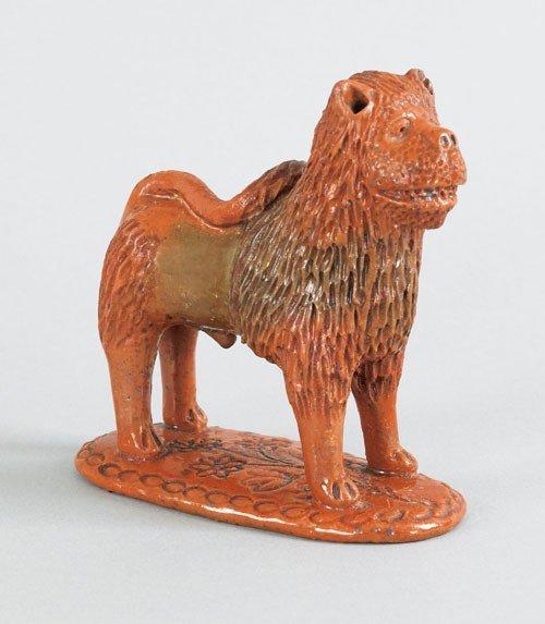 18: Pennsylvania redware figure of a lion, 19th c.,