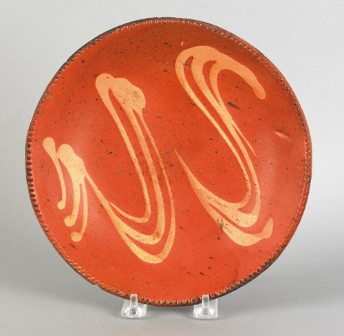 20: American redware pie plate, 19th c., with yello