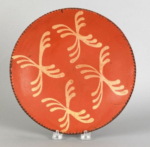 22: Redware pie plate, 19th c., with yellow slip cr