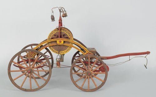 3: Painted wood model of a hand drawn hose reel car