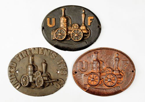 7: Three United Firemen's cast iron fire marks, is