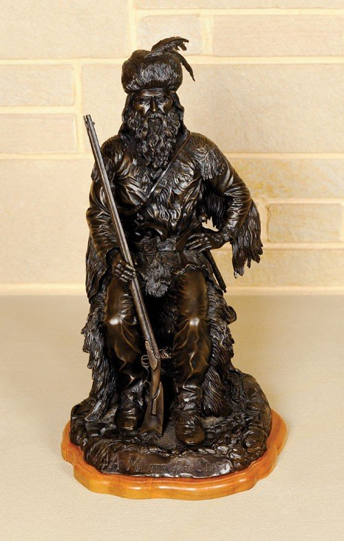 9: Bronze depicting a mountain man in great detail t