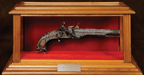 12: Reproduction Pitcairn flintlock revolver.