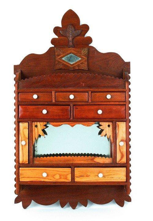14: Folk art walnut hanging cabinet, late 19th c., 33