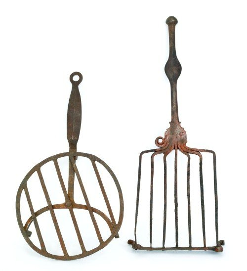 610: Two wrought iron trivets, 18th/19th c., 18 12'' l.