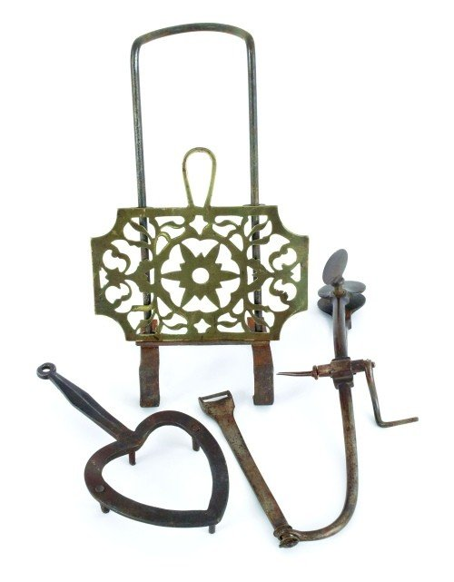 614: Wrought iron heart shaped trivet together with a