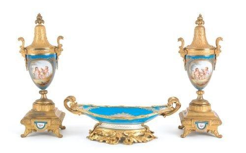 24: Sevres type three-piece ormolu mounted porcelain