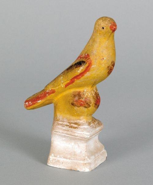 22: Chalkware song bird on perch, 19th c., retainin