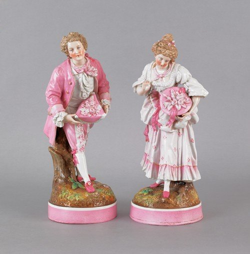 9: Pair of German porcelain figures of a man and wom