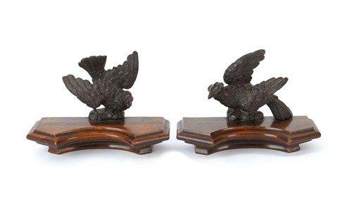 12: Pair of rosewood and mahogany bird wall mounts, l