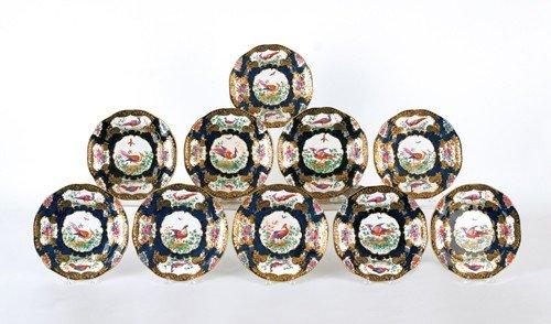22: Set of twelve bird plates by Boothe, 9'' dia.