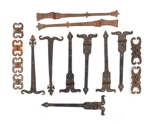 23: Group of wrought iron hinges.