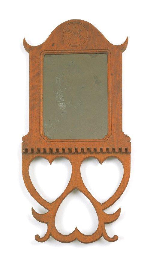 768: Walnut wall mirror, 20th c., with heart cutouts,