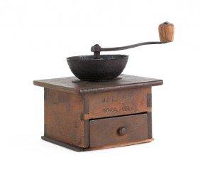 1555: J. Fisher coffee grinder.
