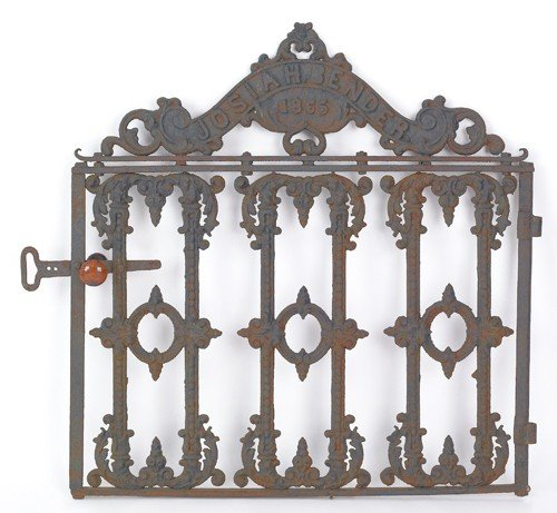 1572: Cast iron gate dated 1865, 41'' h., 39'' w.