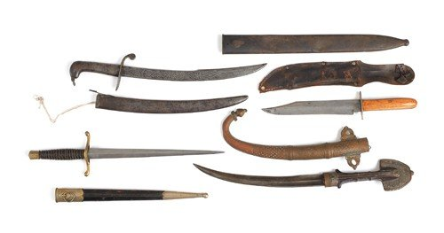 612K: Three daggers, together with a bowie knife.
