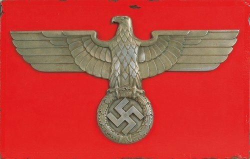 612O: Large metal eagle and swastika on a red board bac