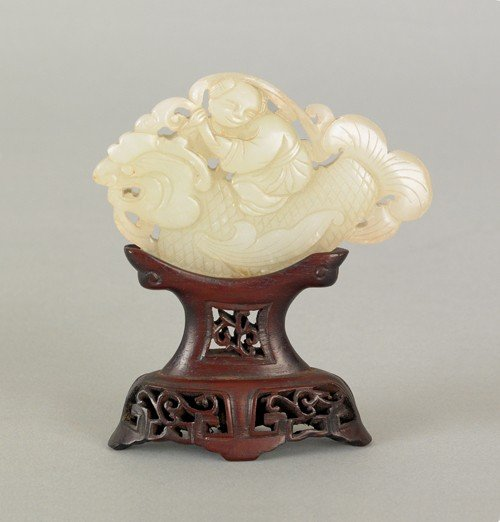 1090: Chinese carved jade plaque with a man riding a se