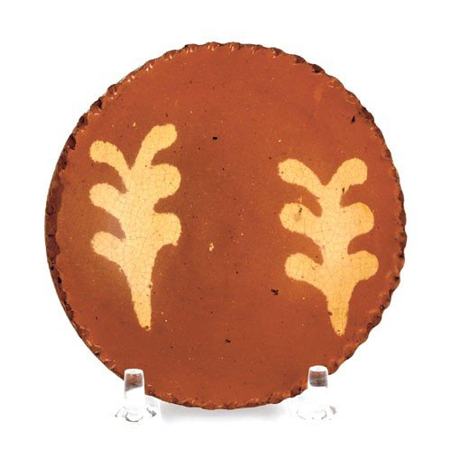 15: Miniature redware plate, 19th c., with yellow s