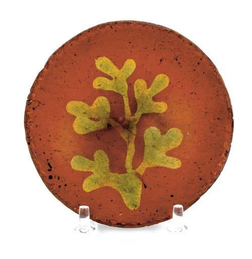 16: Miniature redware plate, 19th c., with yellow a