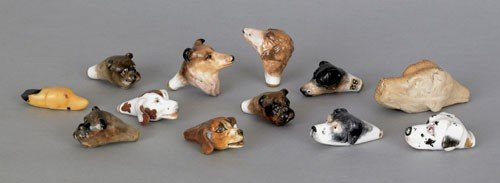 150: Collection of twelve hound-head whistles to inc