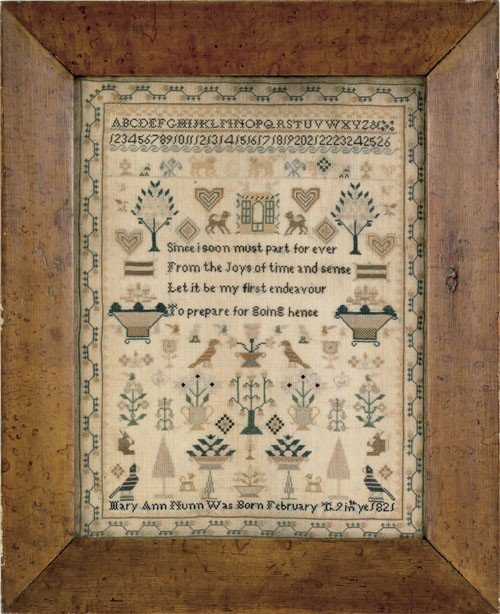 804: Silk on linen sampler with hearts, lions, dogs,