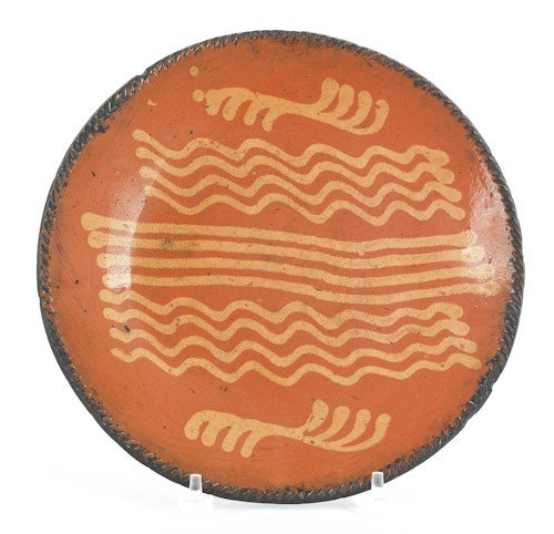 9: Pennsylvania redware charger, 19th c., with yel