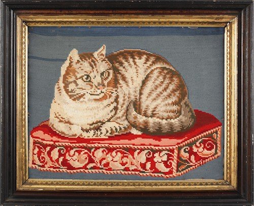 1: Victorian pictorial needlework of a cat resting o