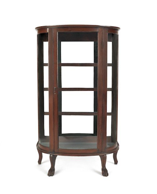 27: Oak bowfront china cabinet, ca. 1900, by the New