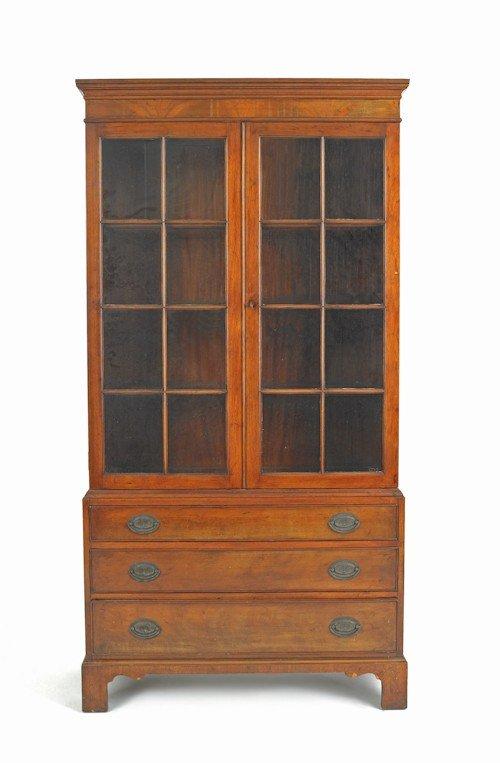 31: Mahogany bookcase, ca. 1930, 69'' h., 35'' w.