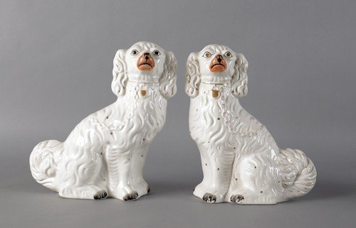 102: Pair of Staffordshire spaniels, 19th c., 13'' h.