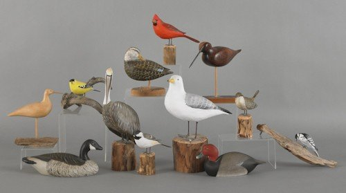 204: Eight carved and painted birds by Peter Peltz, to