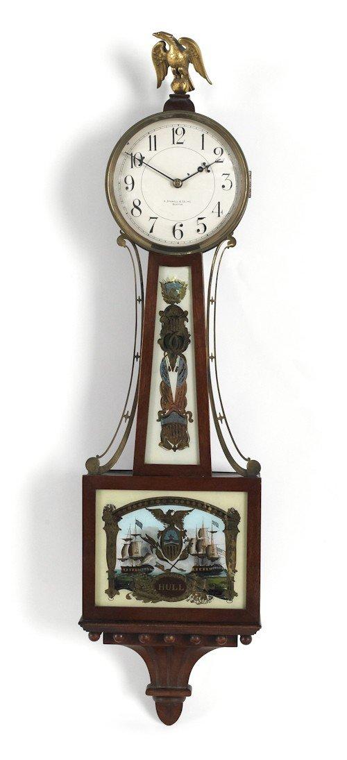 703: Federal style mahogany banjo clock, retailed by A