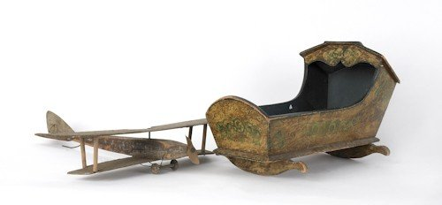 708: Painted doll cradle, together with a biplane weat