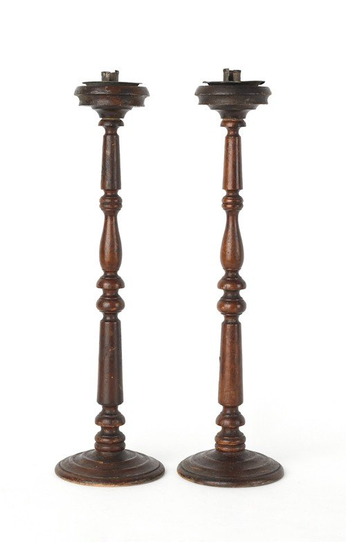 715: Pair of turned wooden candlesticks, 19th c., 23''