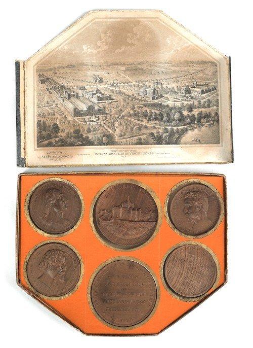 718: Boxed set of six Philadelphia Exposition wooden m