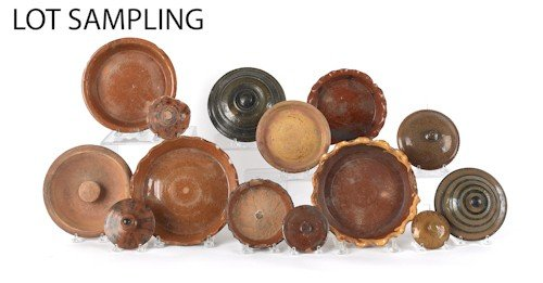 807: Large collection of redware lids and undertrays,