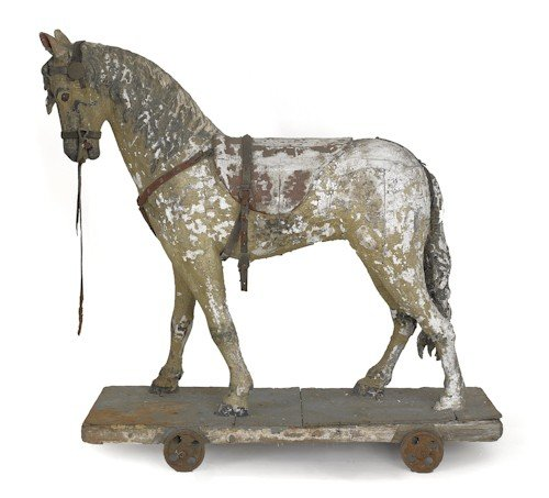 8: Carved and painted riding horse, 19th c., on a