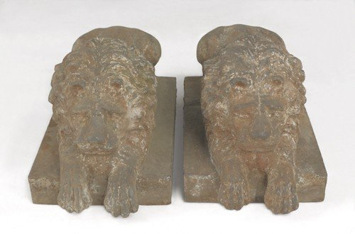 27: Pair of cast iron recumbent lion lawn ornaments,