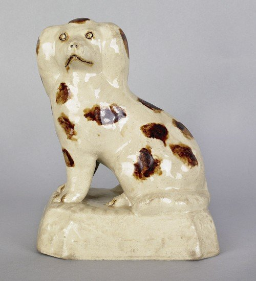 143: Salt glazed seated stoneware spaniel, 19th c.,