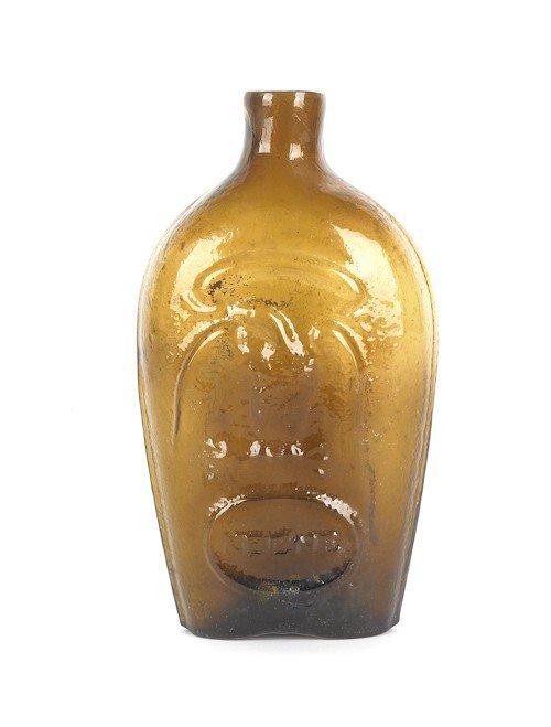 313: Keene olive amber eagle and Masonic flask, 7 1/