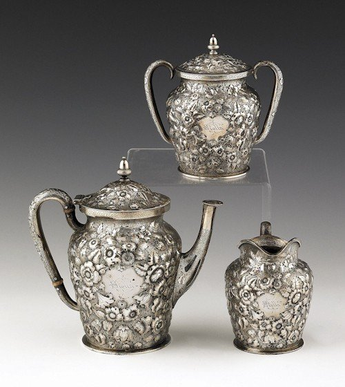 340: Philadelphia three-piece repoussé silver tea ser