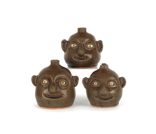 2: Three Georgia stoneware face jugs by Reggie Meade