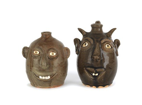 8: Two Georgia stoneware face jugs by David and Regg