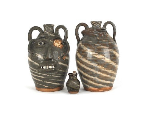 9: Two North Carolina stoneware jugs, together with