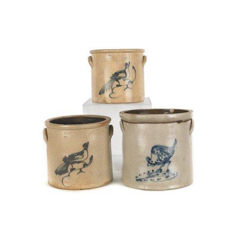 12: Three stoneware crocks, 19th c., with cobalt bird